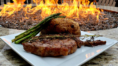 ribeye, asparagus and baked potato at firepit