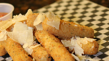 mozzarella sticks with shaved parm on top