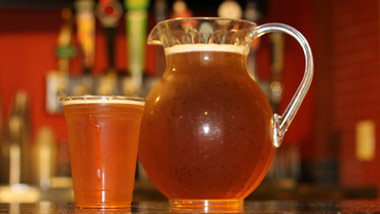 cup of beer with pitcher